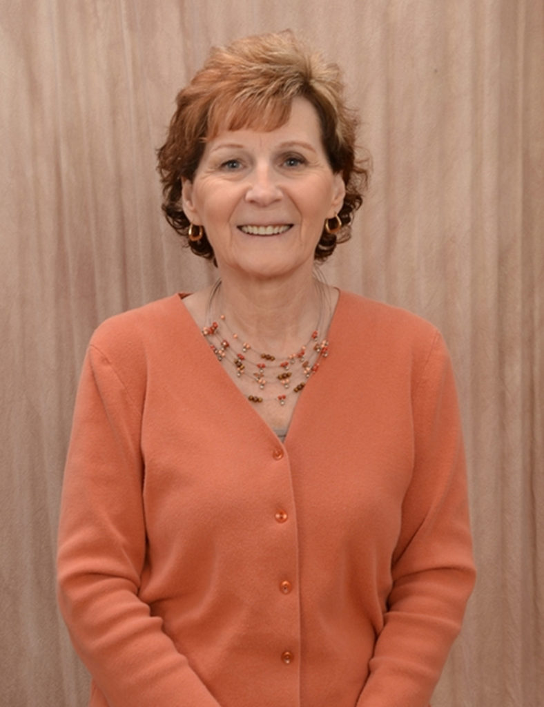 Image of Terri L. Moore in an orange sweater